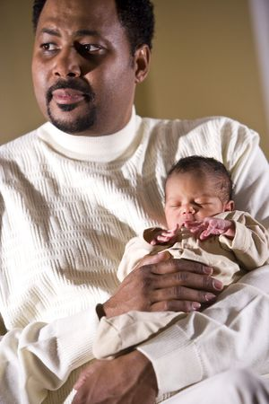 cradling: African American father holding tiny newborn baby Stock Photo