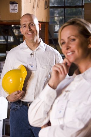 Two co-workers in office storage warehouse Stock Photo - 6329104