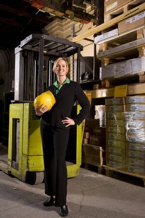 Female office worker standing in storage warehouse Stock Photo - 6329118
