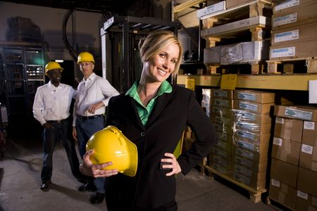 warehouse: Workers with female boss in storage warehouse