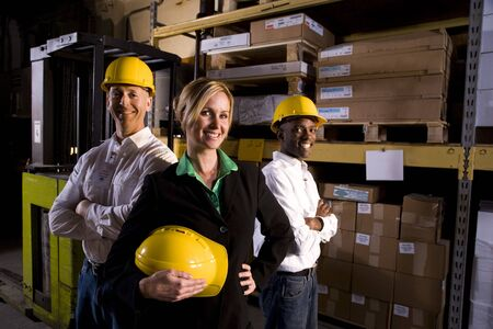 three shelves: Workers with female boss in storage warehouse