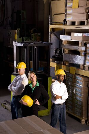 Multi-ethnic workers with female boss in storage warehouse Stock Photo - 6329140