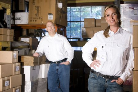 Two office coworkers in storage warehouse Stock Photo - 6329114