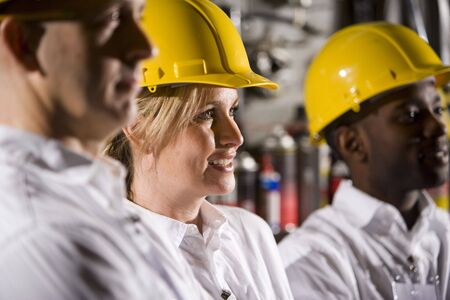 hard hats: Close up of coworkers wearing hard hats Stock Photo