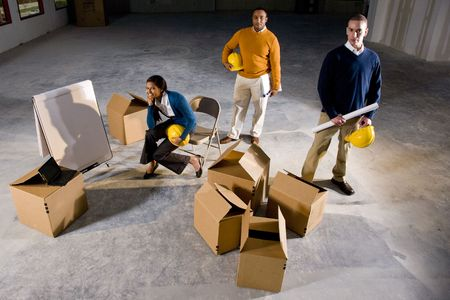 Multi-ethnic businesspeople preparing new office space photo