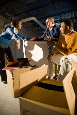 new office space: Multi-ethnic businesspeople moving into new office space