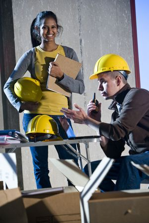 Multi-ethnic male and female construction workers photo
