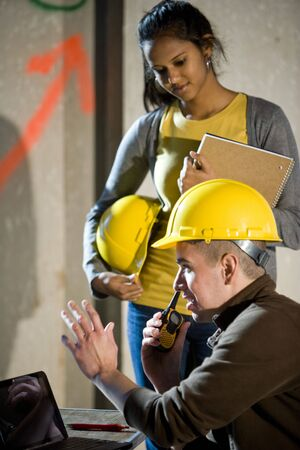 Close-up of male and female construction workers photo