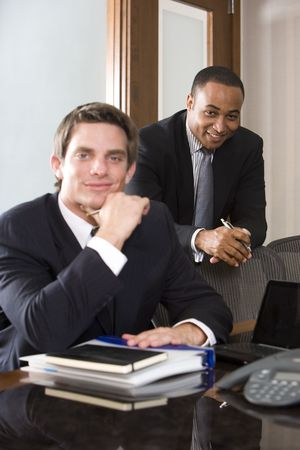 Young businessman with mature African American colleague photo