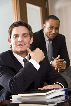Young businessman with mature African American executive behind photo