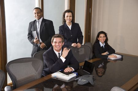 Young businessman with Hispanic businesswomen and African American male colleague photo