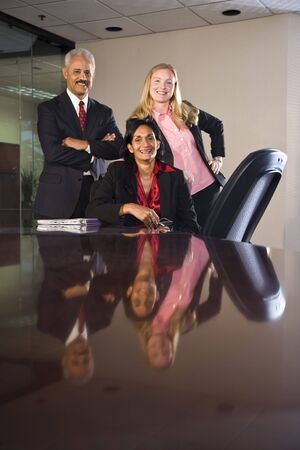 Multi-ethnic businesspeople in boardroom photo
