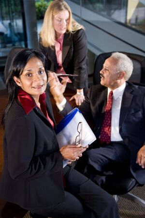 Asian businesswoman in meeting with African American businessman and female colleague Stock Photo - 6375561