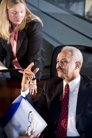 African American businessman meeting with female business colleagues photo
