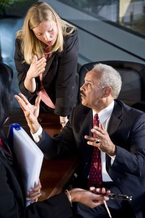 African American businessman meeting with female business colleagues Banco de Imagens