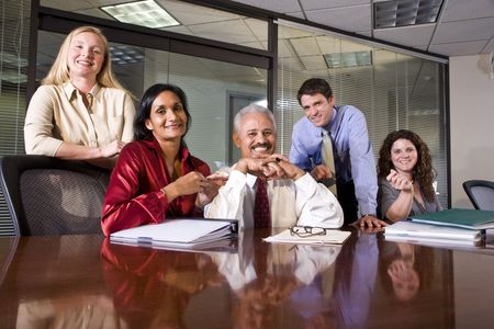 Multiethnic business team meeting in an office conference room photo