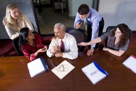 Multi-ethnic businesspeople meeting at table in boardroom Stock Photo - 6375545