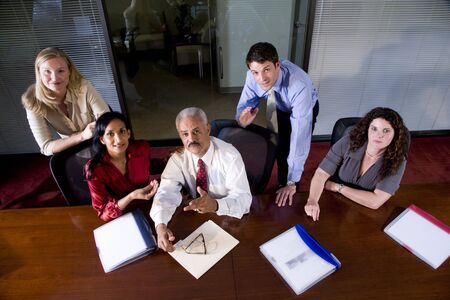 Multi-ethnic businesspeople sitting at boardroom table Stock Photo - 6375554