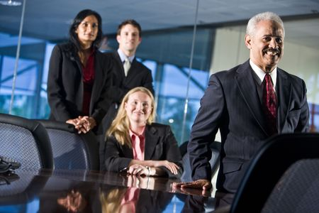 Businessman smiling with colleagues behind photo