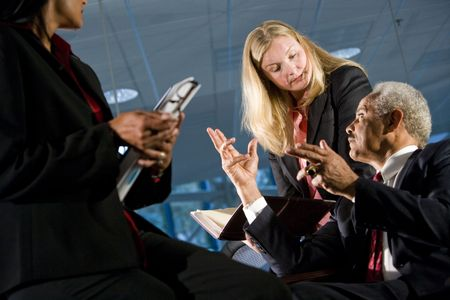 African American businessman having discussion with female colleagues photo