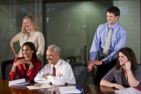 African American businessman with business team in boardroom photo