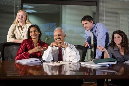 Multi-ethnic group of office workers in boardroom photo