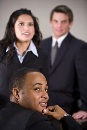 Close-up of three multiracial business executives in a meeting photo