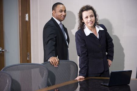 Multi-ethnic business executives standing in boardroom photo