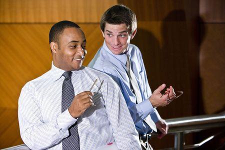 conversing: Multiracial male business colleagues conversing