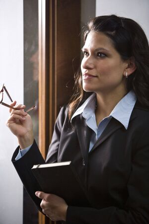 Close up of young Hispanic businesswoman photo