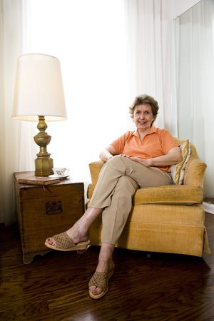 Elderly woman relaxing at home Stock Photo