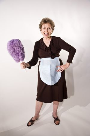 Senior woman in her 70s wearing maid's uniform