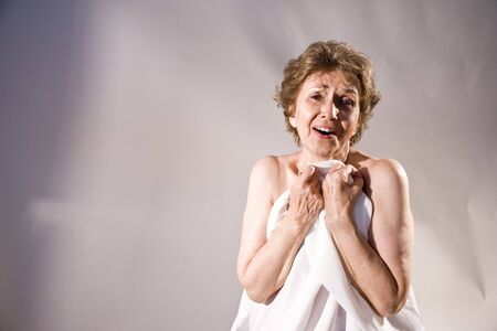 aging woman: Portrait of ecstatic senior woman in her 70s Stock Photo