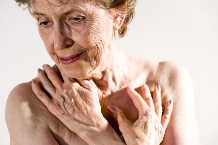 Senior woman in her 70s with wrinkled skin