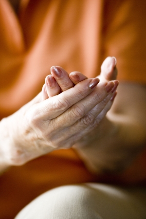 hand rubbing: Close-up of hands of senior woman in her 70s