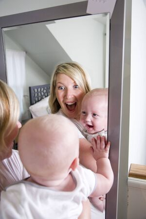 mirror: Mother and 7 month old baby playing in mirror
