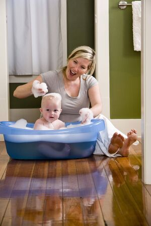 Mother giving 7 month old baby a bath Stock Photo - 6610694