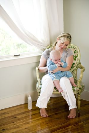 Mother burping baby after bottle-feeding Stock Photo - 6610680