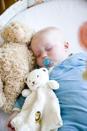 Seven month old baby sound asleep in crib Stock Photo - 6610599