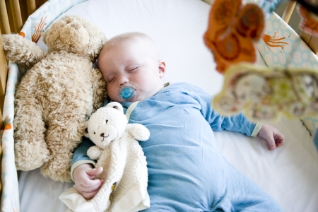 Seven month old baby sound asleep in crib Stock Photo - 6610678