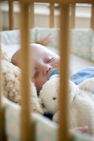 Seven month old baby sound asleep in crib Stock Photo - 6610654