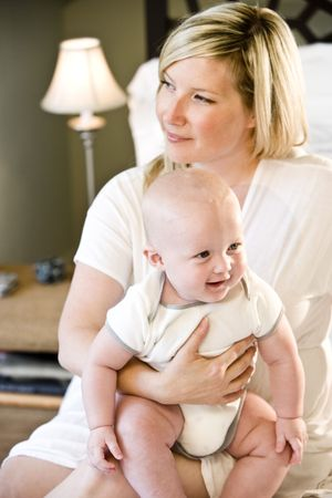 Mother holding happy seven month old baby on her lap Stock Photo - 6610693