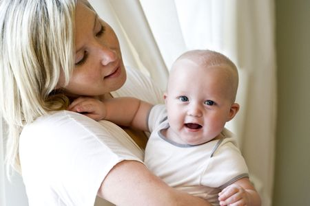Mother holding happy seven month old baby Stock Photo - 6610553