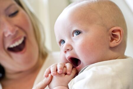 Close-up of mother holding seven month old baby Stock Photo - 6610665