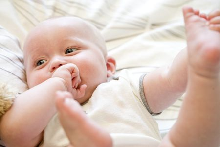 Close up of seven month old baby lying on back Stock Photo - 6610658