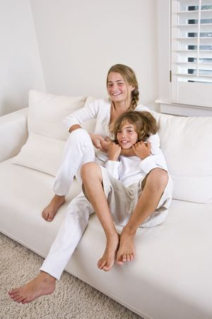 tween boy: Brother and sister at home relaxing in white room