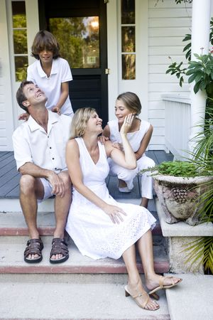 front porch: Family together on front porch step Stock Photo