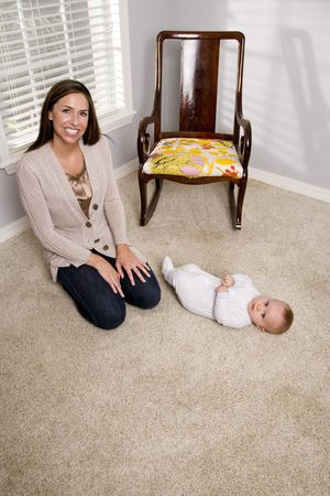 Mother with six month old baby at home photo