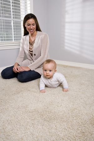 Mother with six month old baby at home Stock Photo - 6644384