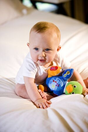 Cute six month old baby playing with a toy Stock Photo - 6644299